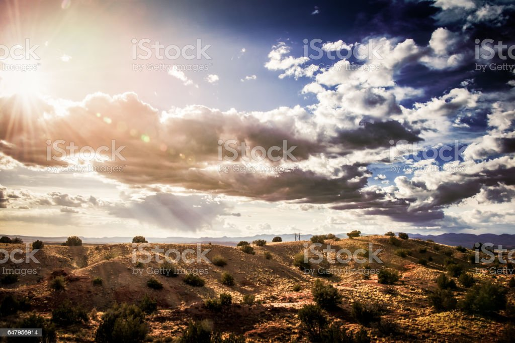High Desert Sunset with Blue Sky and Fluffy Clouds stock photo
