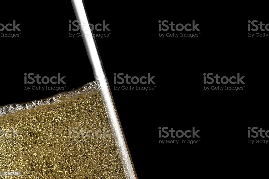 high detail of one flute tilted of champagne stock photo