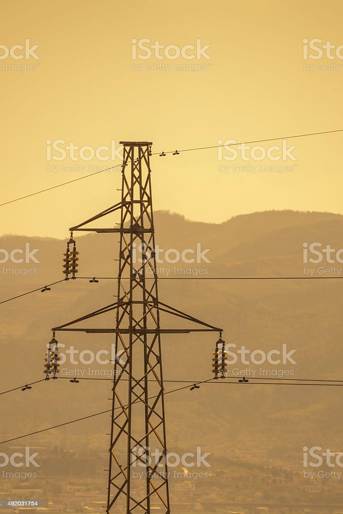 High electrical power pole with warm color stock photo