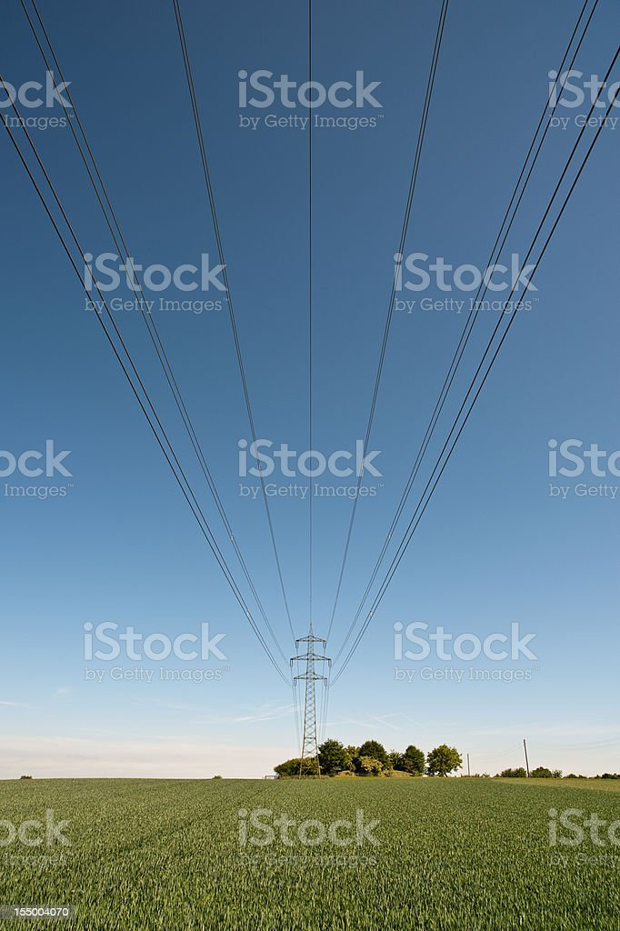 High electricity pylon power lines and nature stock photo