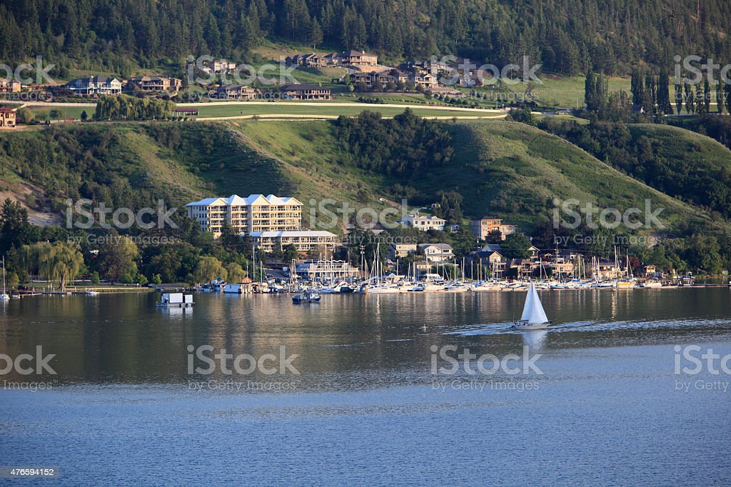 High End Homes And Yacht Club With Lake in Foreground stock photo