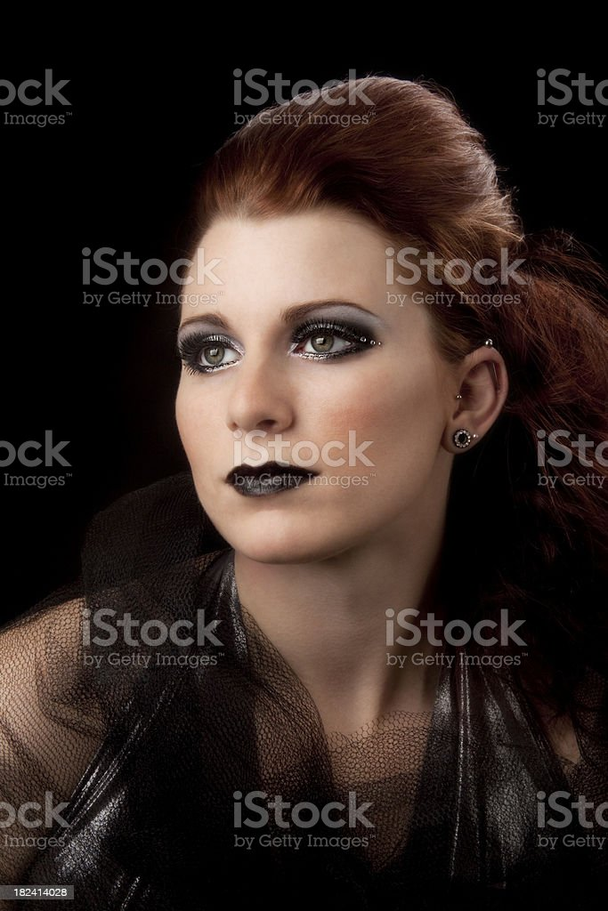 High fashion: elegant model with goth look on black royalty-free stock photo