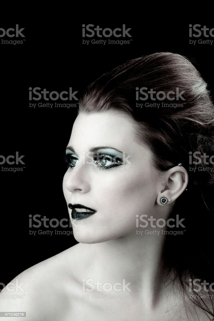 High fashion: elegant model with goth look on black stock photo