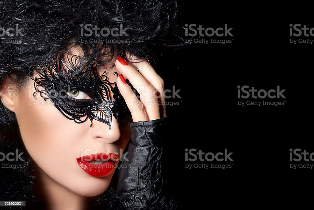 High Fashion Model Wearing Creative Masquerade Eye Makeup stock photo