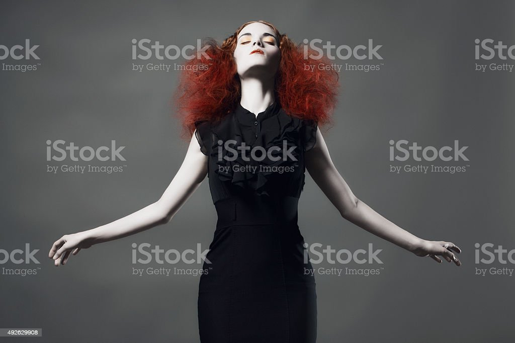 High Fashion Model with Arms Out and Eyes Closed stock photo