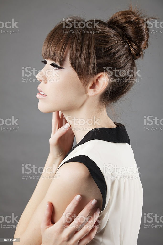 High fashion: profile of an elegant asian model on grey stock photo
