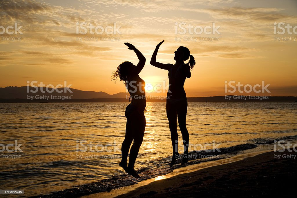 High Five Silhouette at Sunset royalty-free stock photo