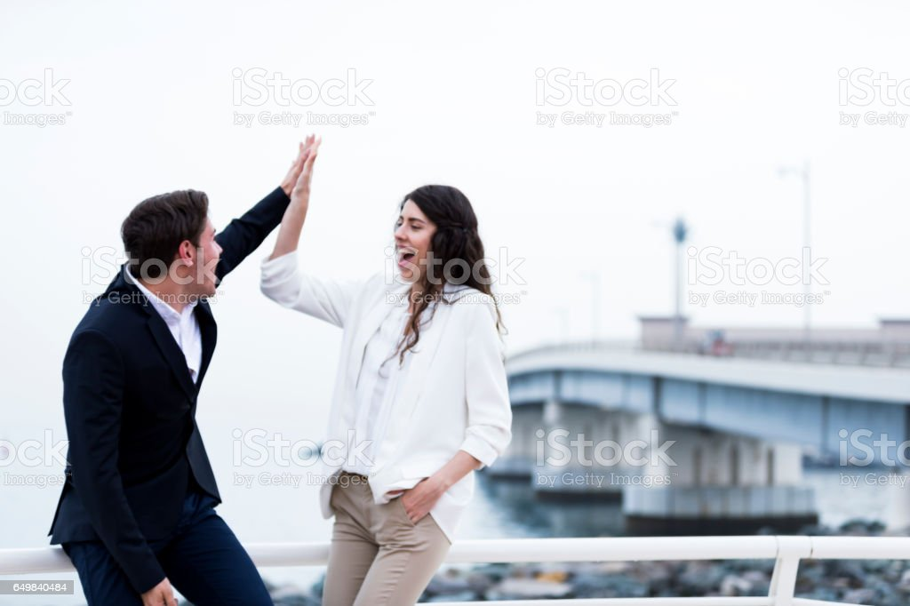 High five to such a great news. stock photo