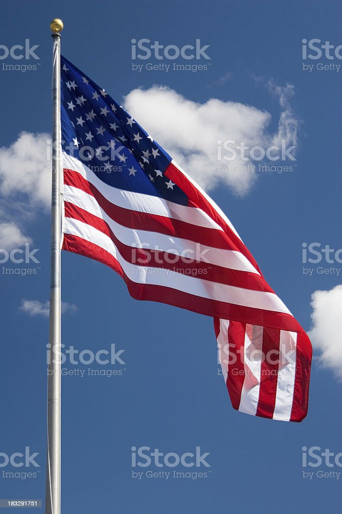 High Flying Flag with Clouds stock photo