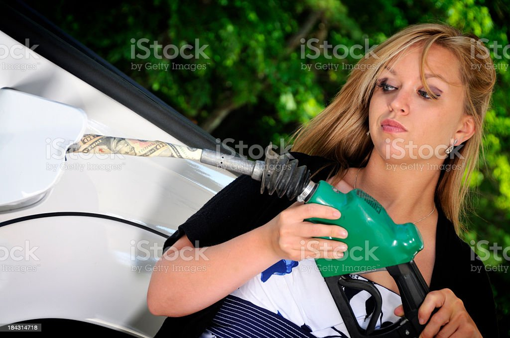 High Fuel Prices Like Pumping Money stock photo