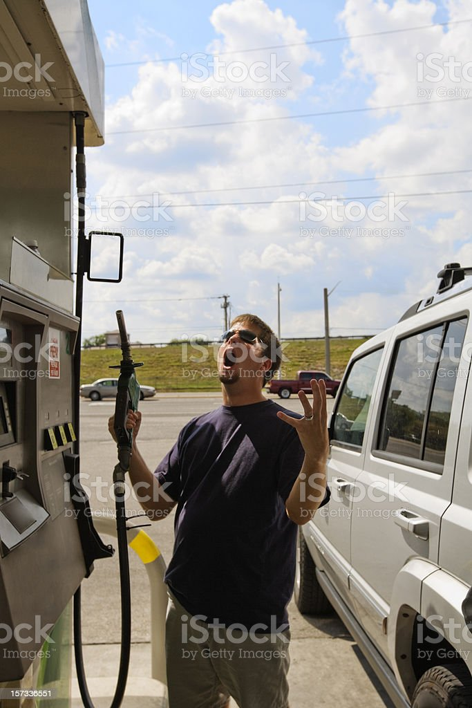 High Gas Price Frustration Man Refueling stock photo