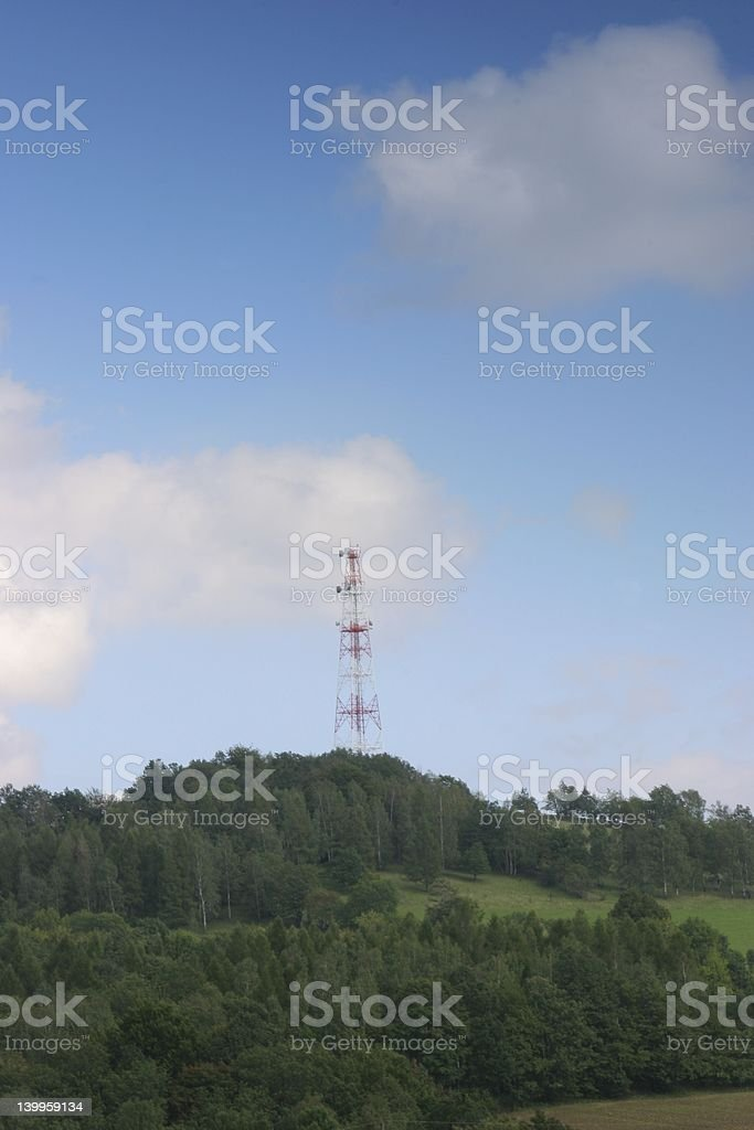 High GSM Antenna on palate sky hill royalty-free stock photo