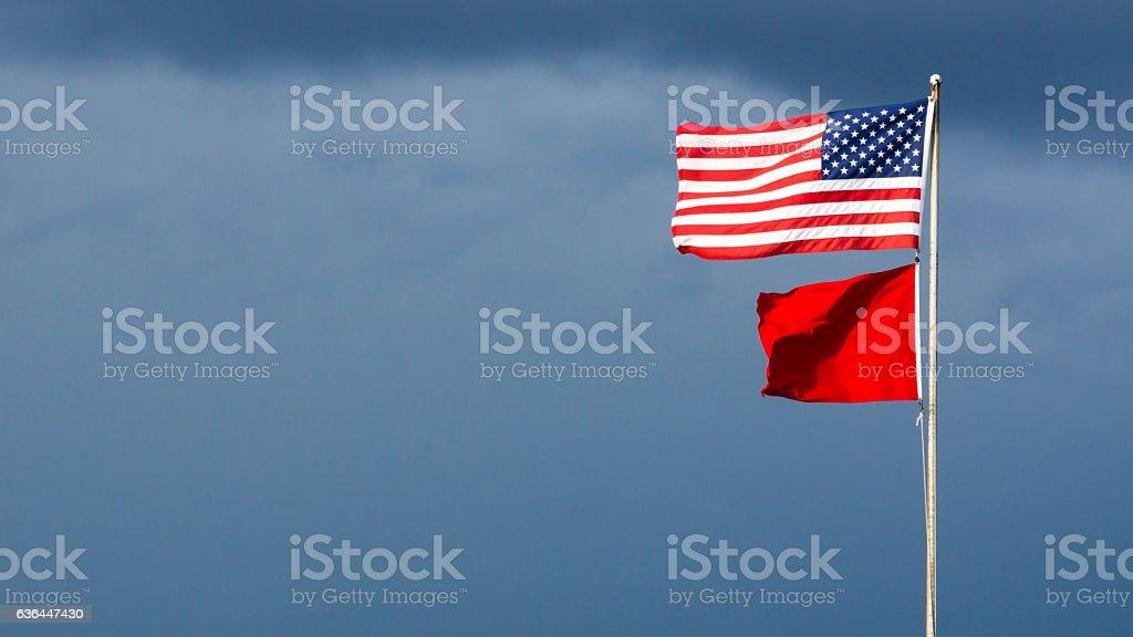 High hazard flag on a beach pier stock photo
