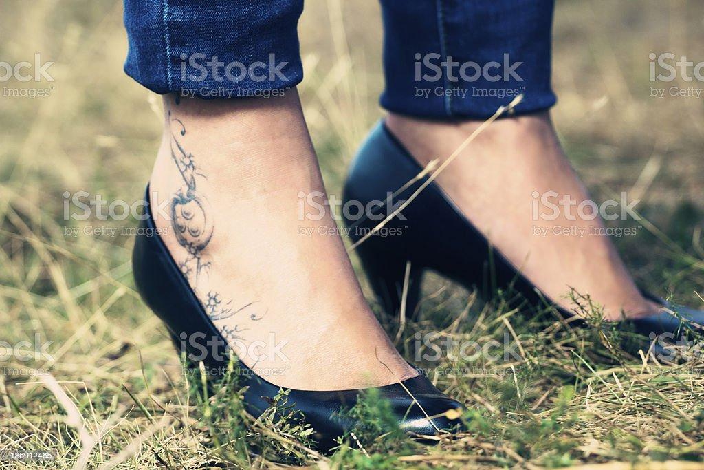 High heals and tatoo royalty-free stock photo