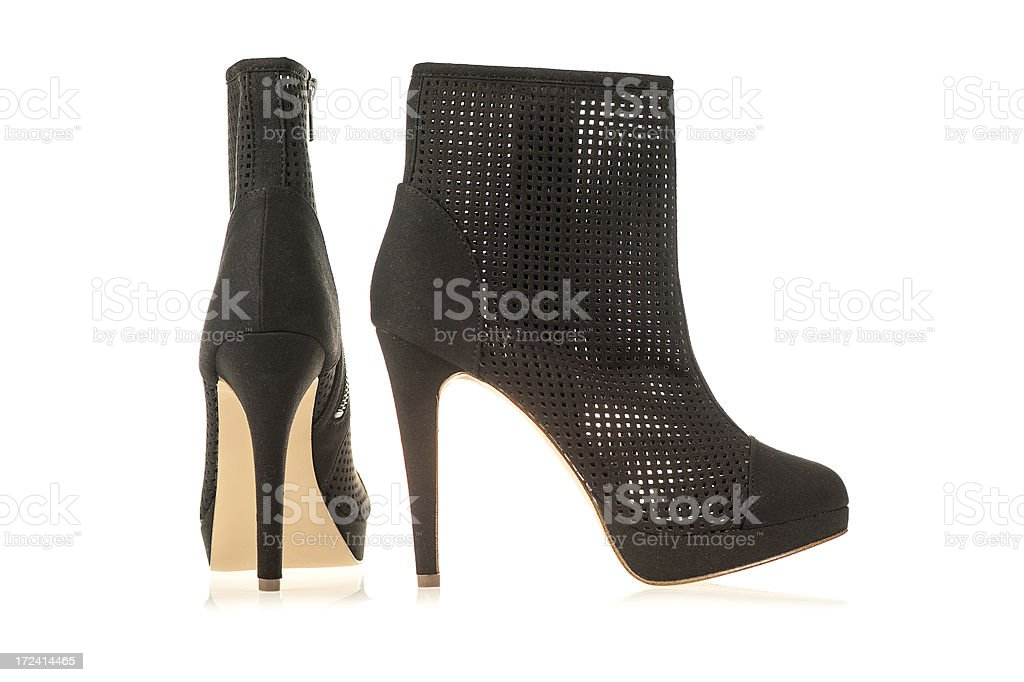 High heels ankle boots in black royalty-free stock photo