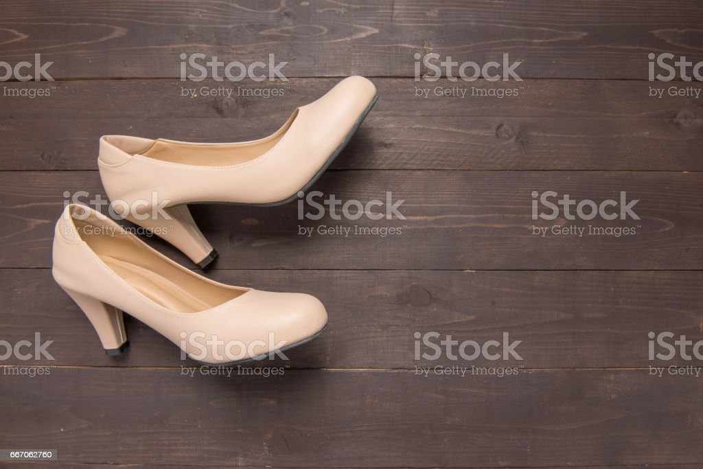 High heels are on wooden background with copy space stock photo