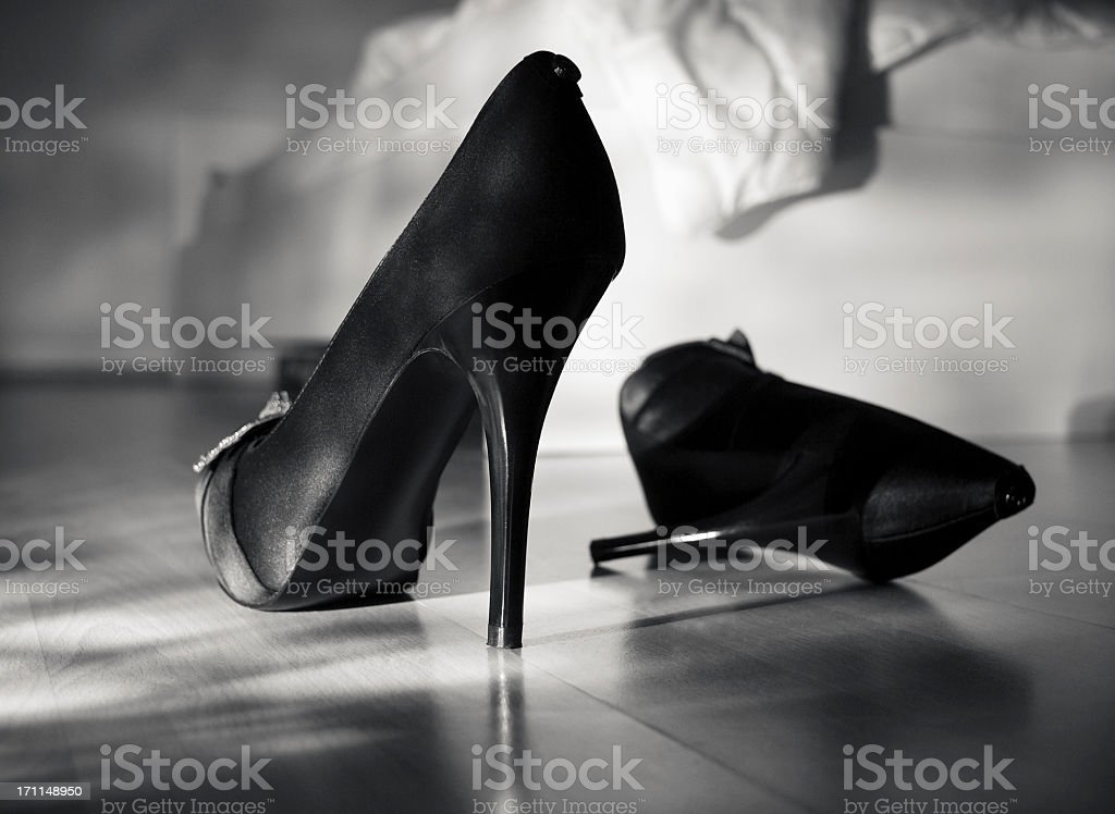 High heels by the bed stock photo