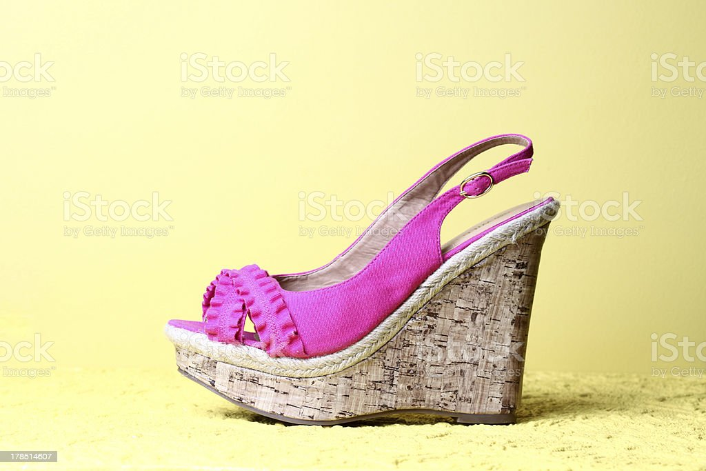 High heels in fashionable wedge style and yellow background stock photo