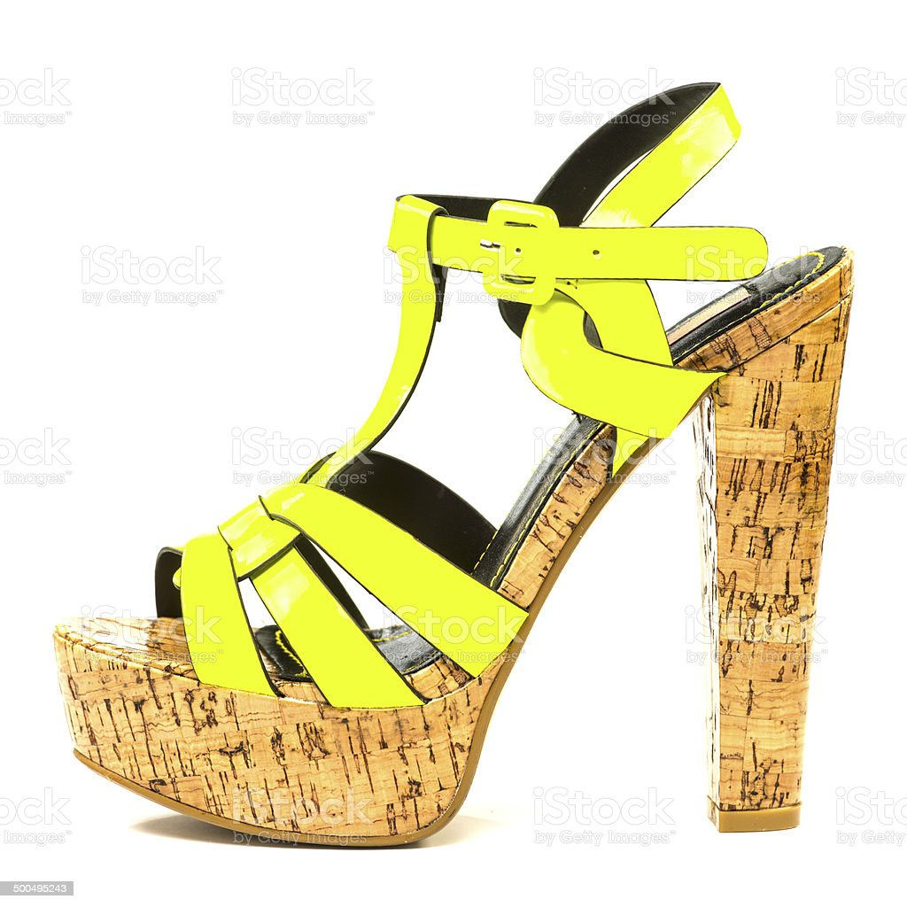 High heels sandals in signal yellow with cork sole stock photo