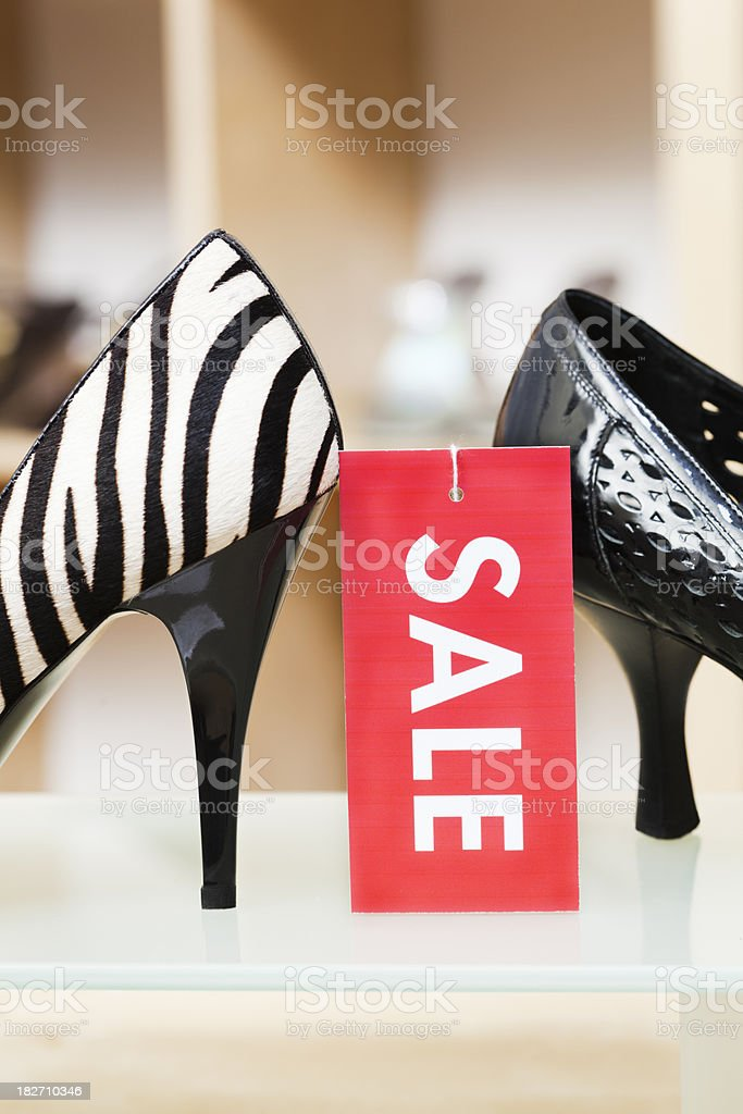High Heels Shoes Retail Store Display with Sale Sign Vt royalty-free stock photo