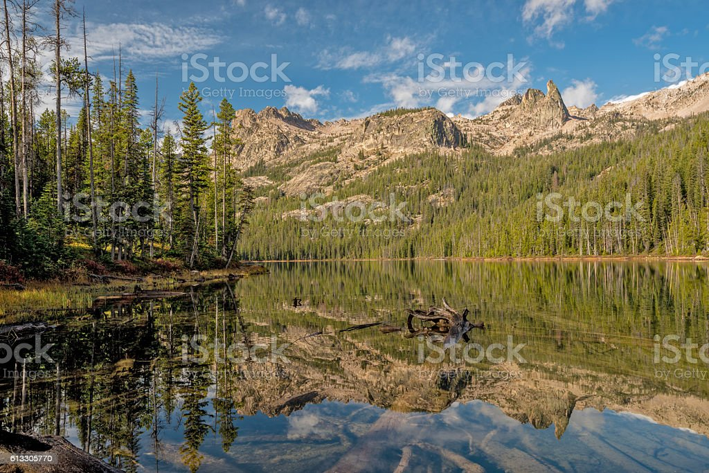 High Idaho mountain lake reflection with clouds stock photo