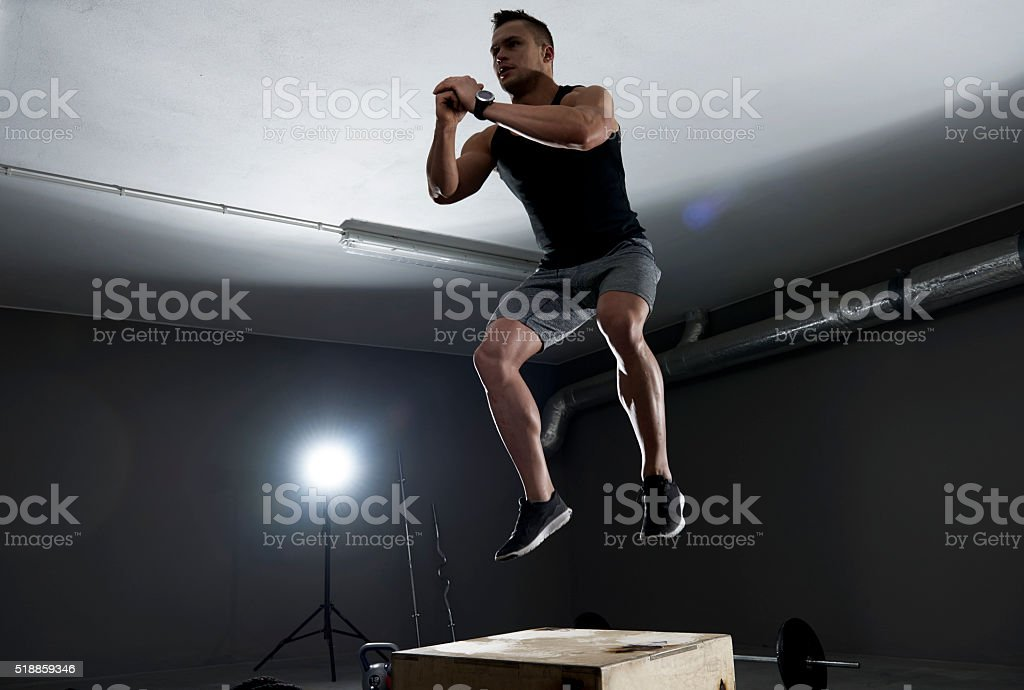High jump on the wooden box stock photo