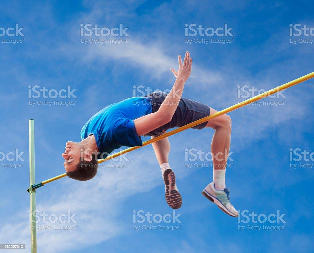 High Jumper Against Sky stock photo