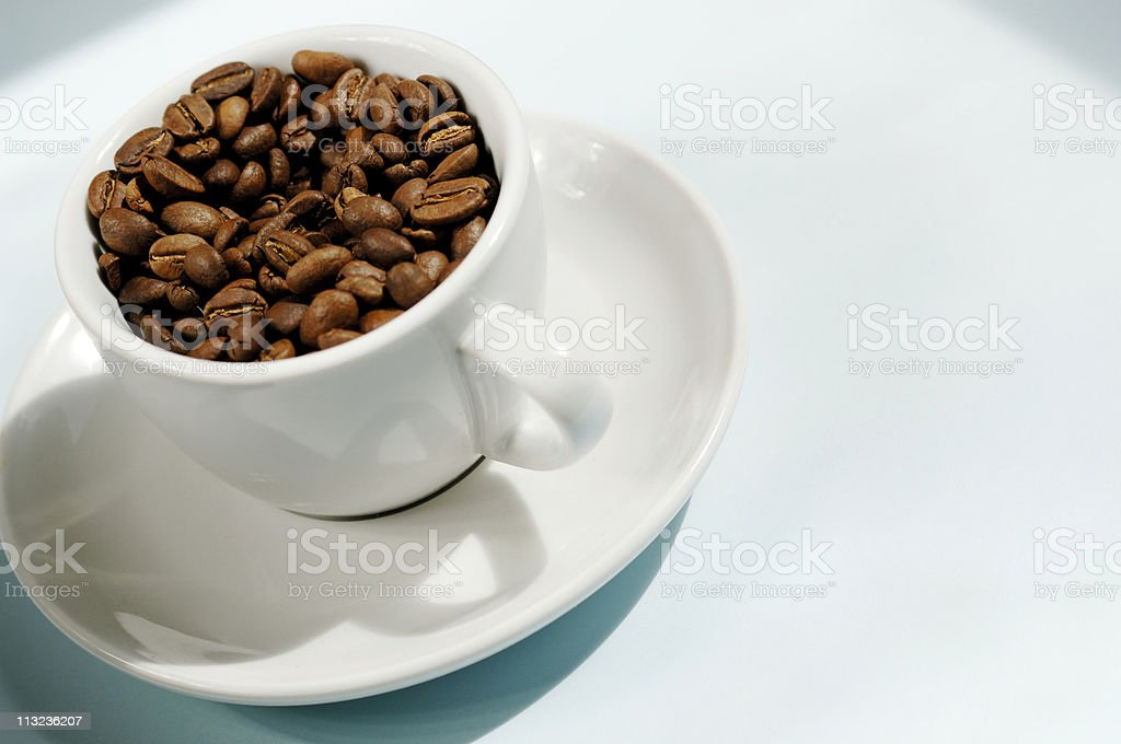 high key coffee cup with roasted beans against pale blue royalty-free stock photo