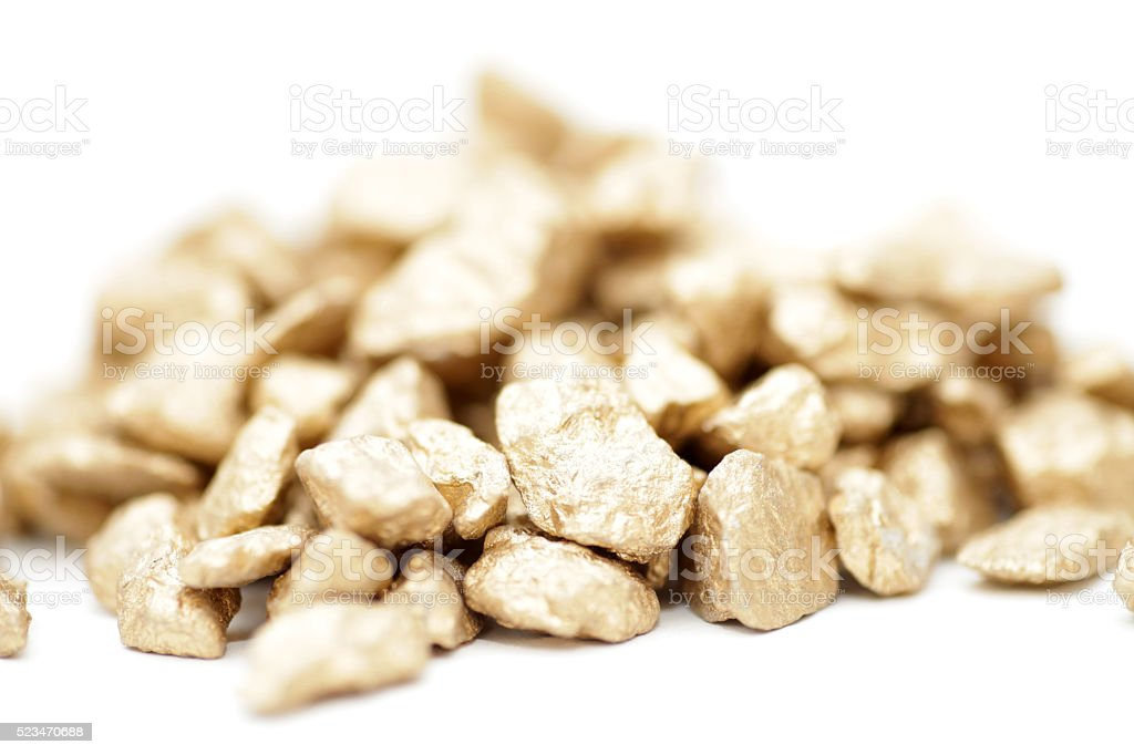 High key macro of gold nuggets stock photo