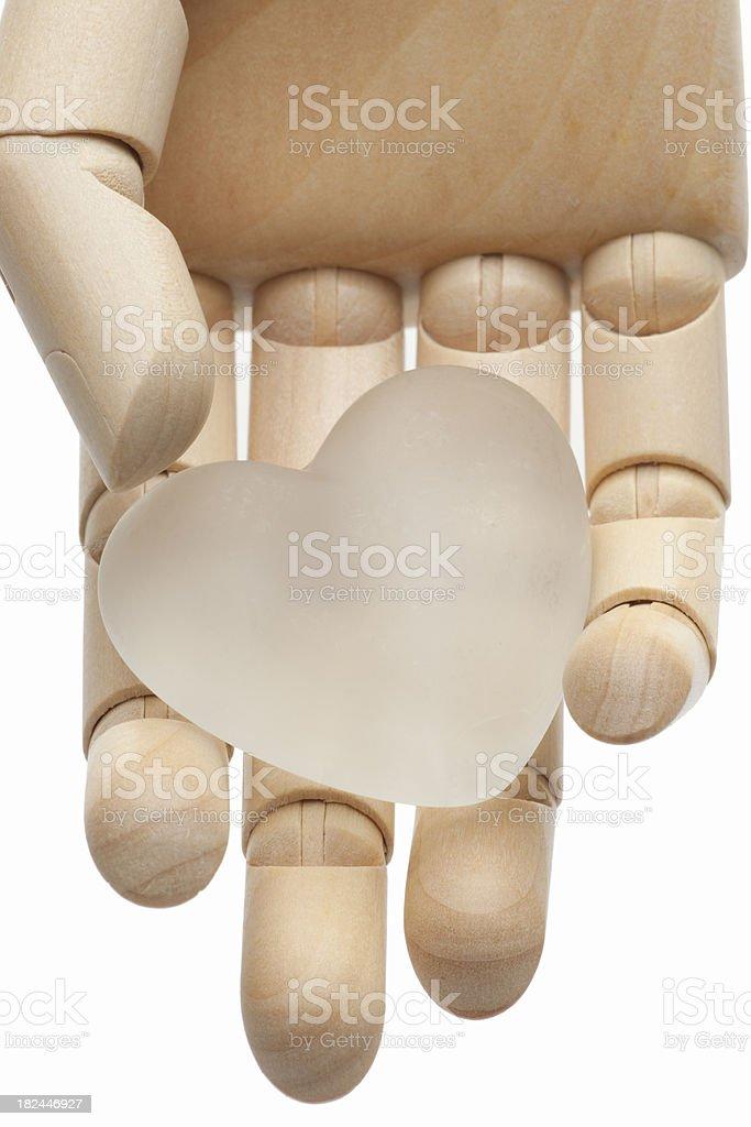 High Key White Glass Heart in Wood hand stock photo