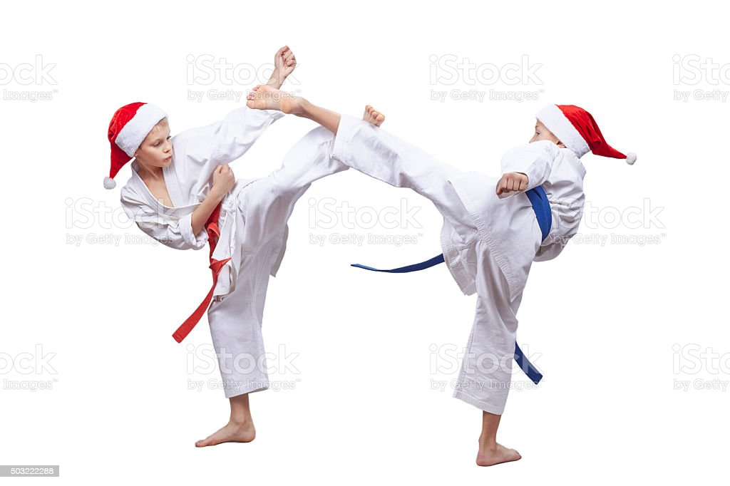 High kicks legs are training athletes in caps of Santa stock photo