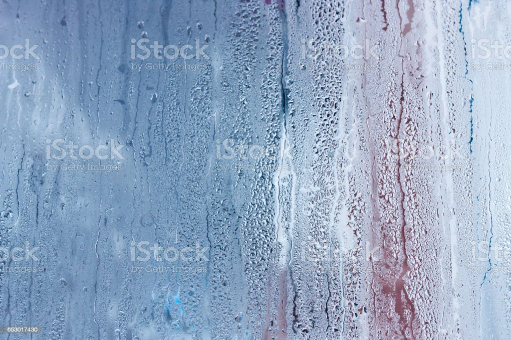 High level of humidity. Condensation drops pouring down the glass windows stock photo