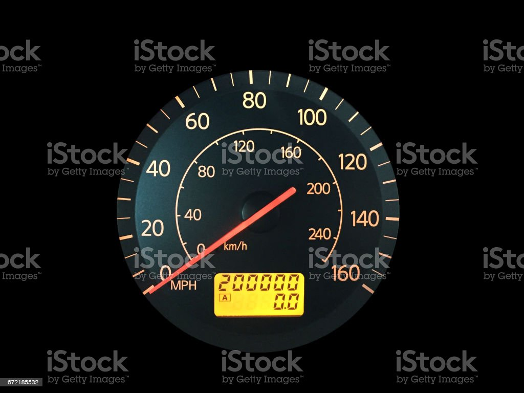 High Mileage Odometer Isolated on Black stock photo