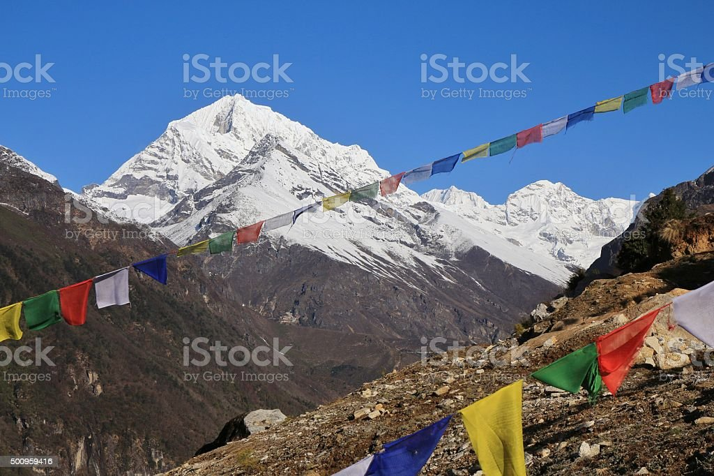 High mountain and prayer flags near Namche Bazaar stock photo