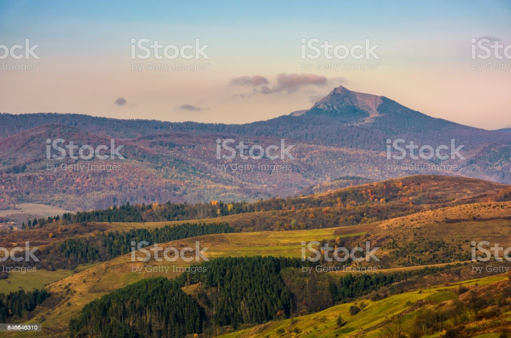 high mountain peak behind the hills stock photo