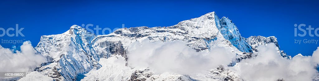 High mountain peaks panorama snowy summits tumbling glaciers Himalayas Nepal stock photo