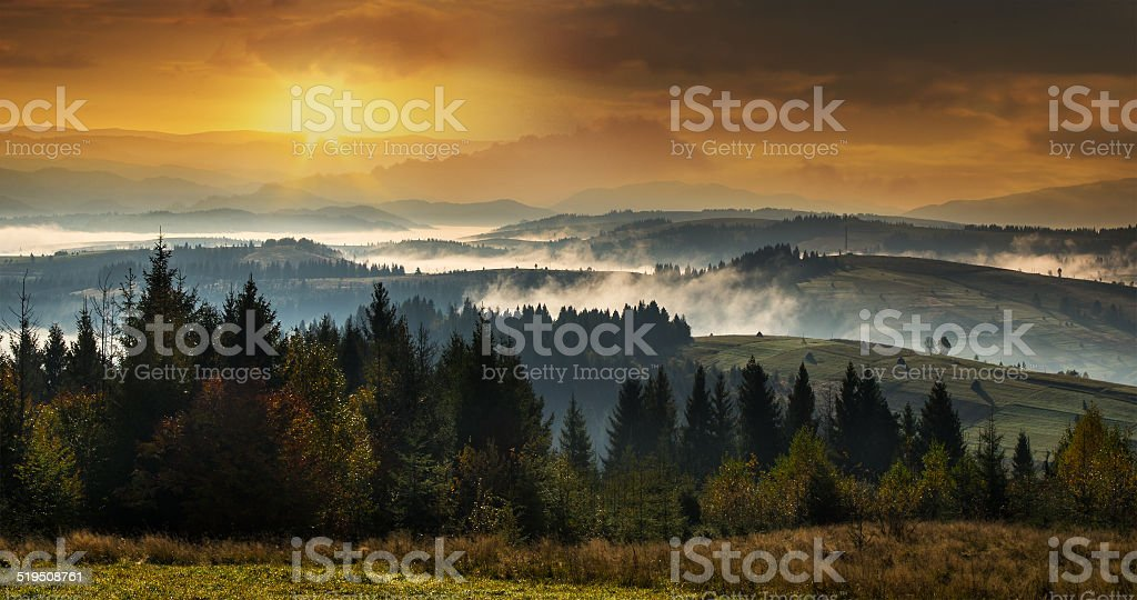 High mountains at sunset with a dense fog. stock photo