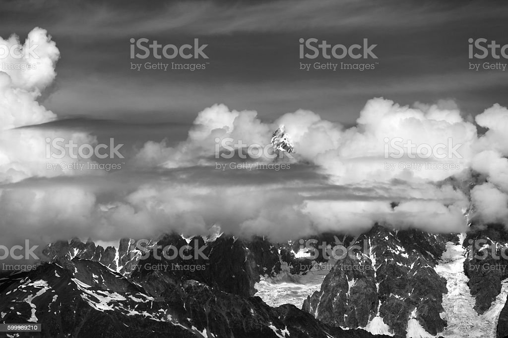 High Mountains covered with clouds stock photo