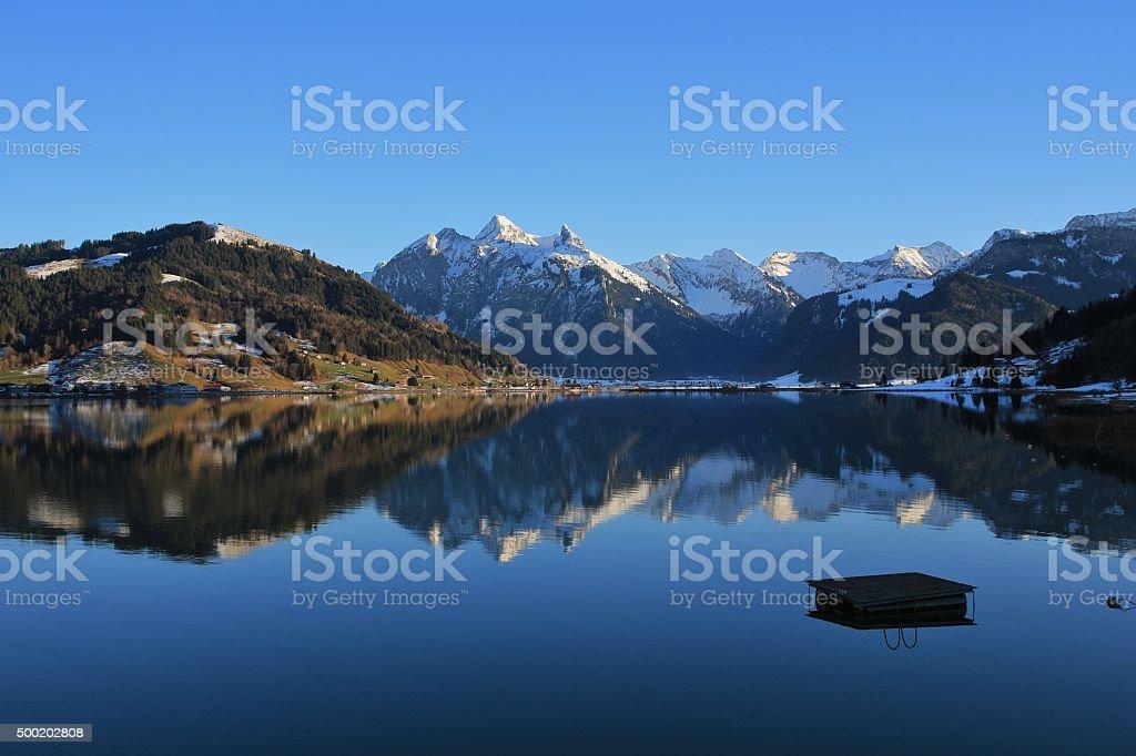 High mountains mirroring in lake Sihlsee stock photo