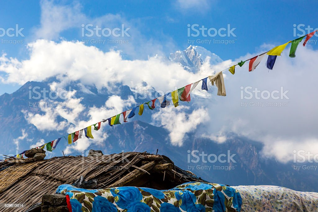 High Mountains View with Nepalese prayer flags garland stock photo