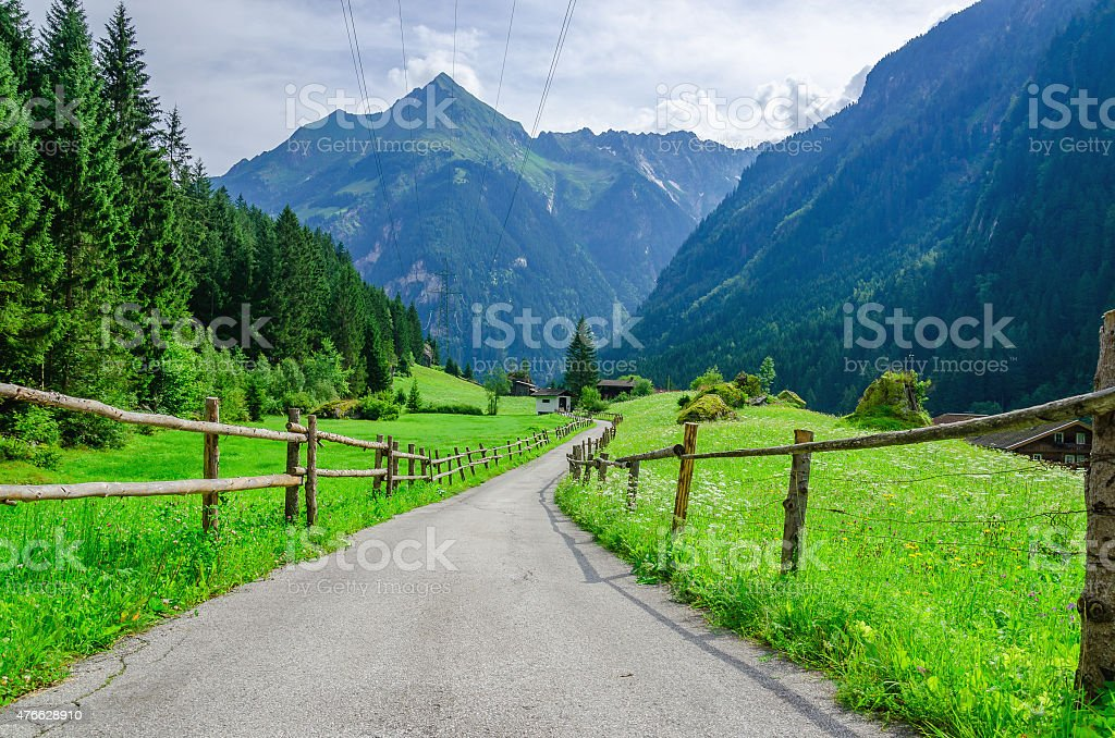 High peaks of the Alps with coutry road,  Austria stock photo