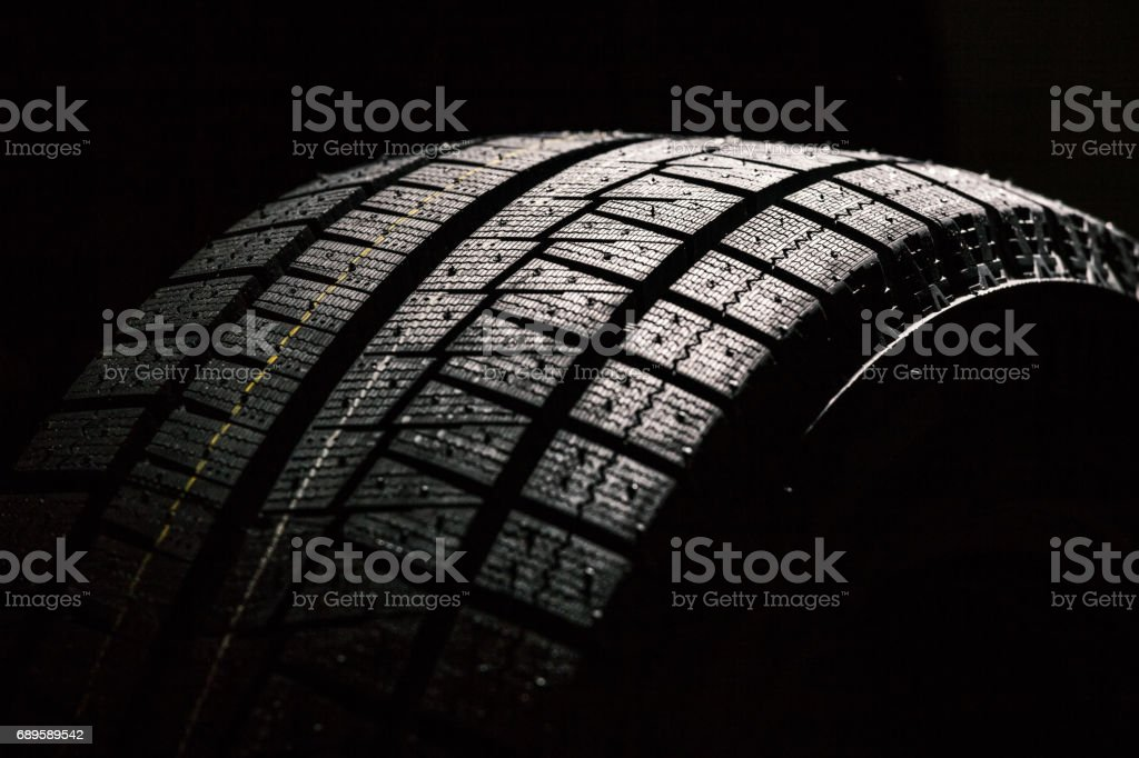 High Performance Winter Tire On Black Background stock photo