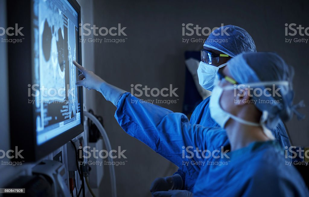 High performing surgeons know the value of teamwork stock photo
