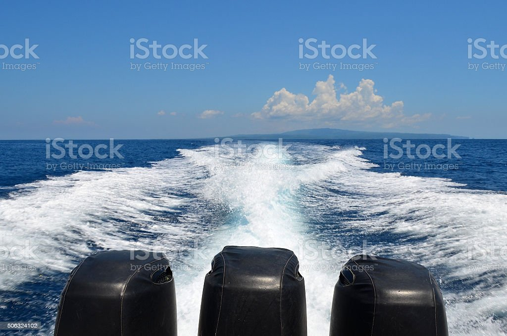 High powered speed boat moving across the ocean stock photo