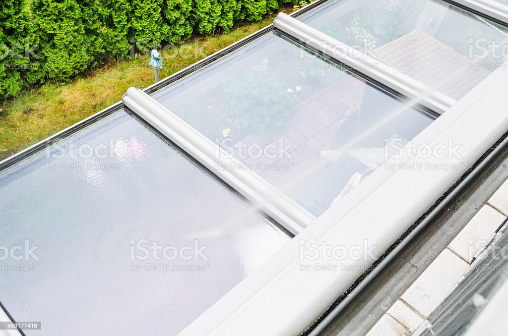 High Pressure Cleaning glass roof stock photo