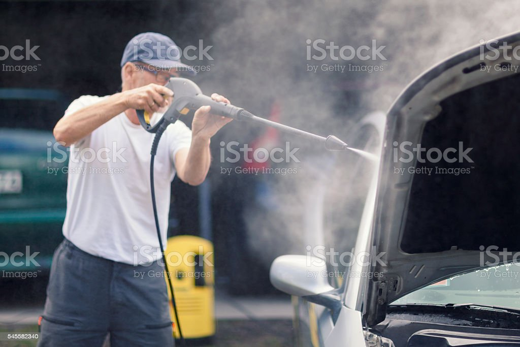 High pressure cleaning the car stock photo