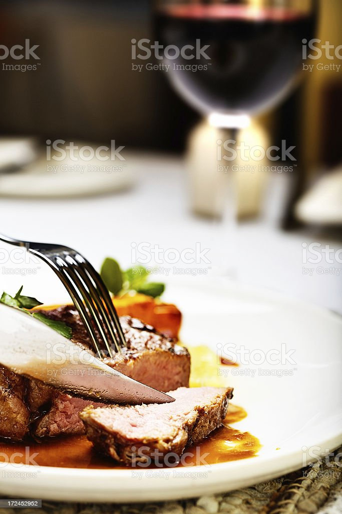 High protein meal of rare steak and red wine royalty-free stock photo