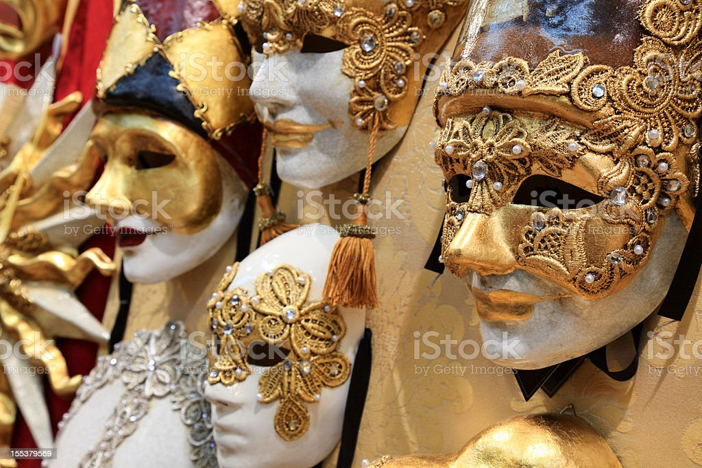 High quality carnival masks hanging on the wall stock photo