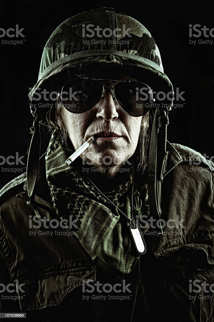 high rank officer enjoying one cigaret after a difficult mission stock photo
