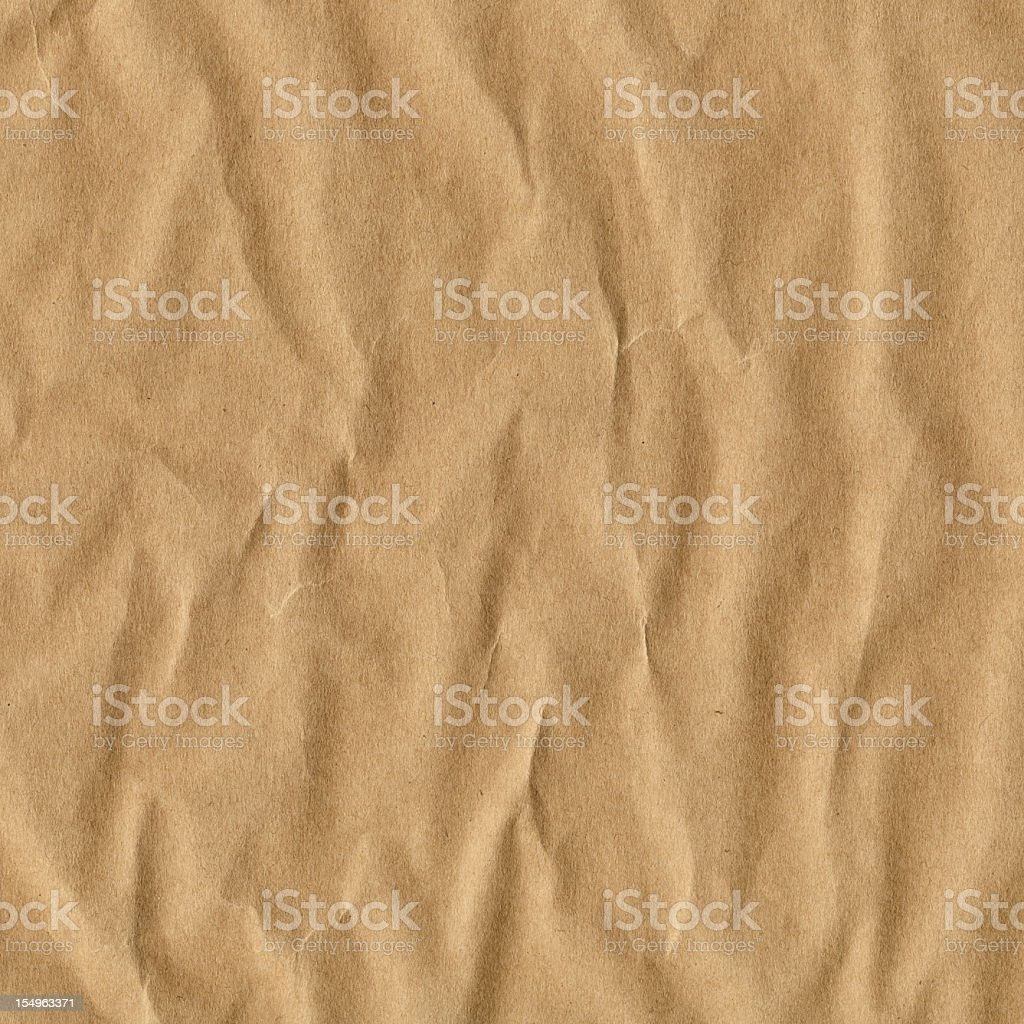 High Resolution Brown Kraft Wrapping Paper Crushed Crumpled Grunge Texture royalty-free stock photo